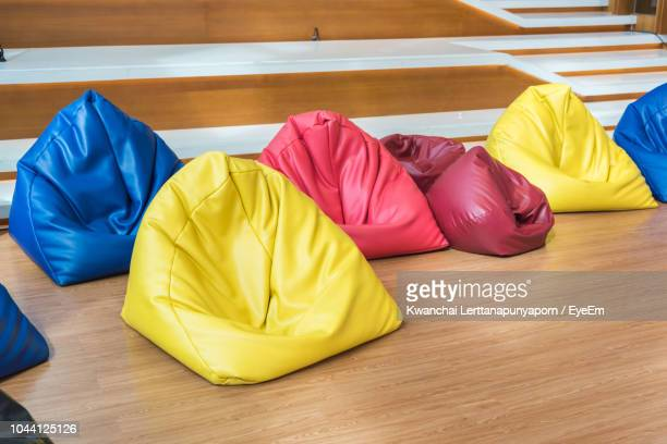 small bean bags on hardwood floor - sacco photos et images de collection