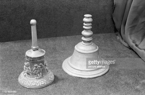 A small bell with barely comprehensible figurative representation and inscribed SIT NOMEN DOMINI BENEDICTUM in Posadas Argentina 1957   usage...