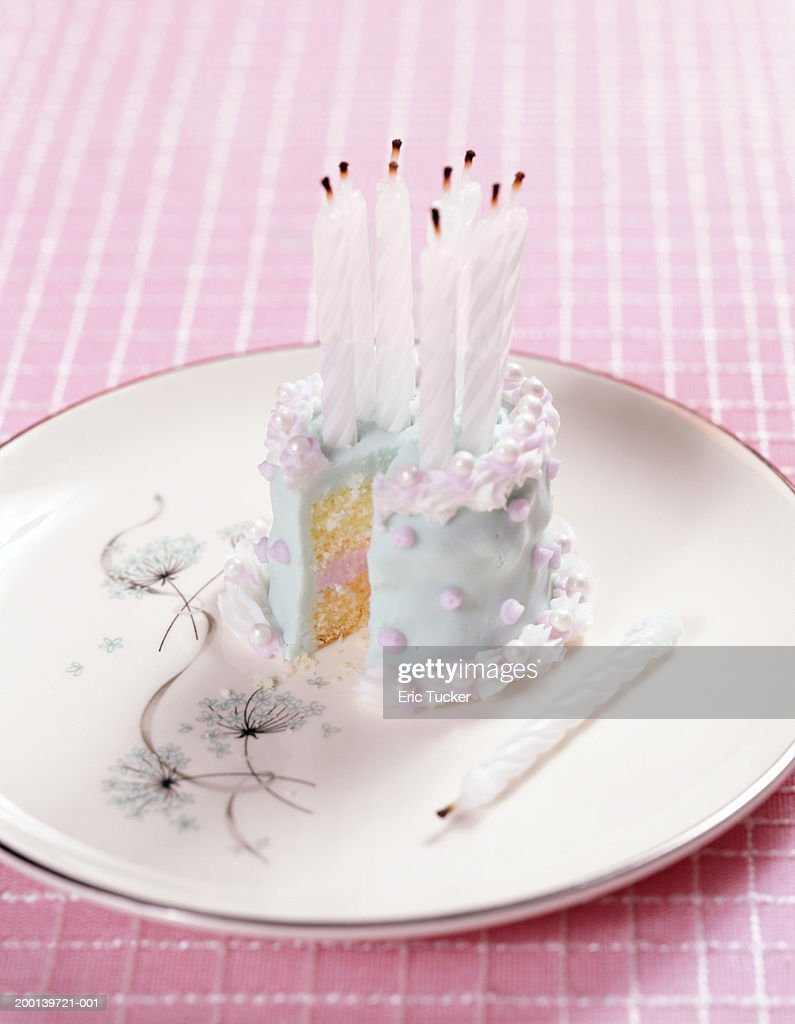 Pleasant Small Birthday Cake With Blown Out Candles On Plate Missing Slice Funny Birthday Cards Online Inifofree Goldxyz