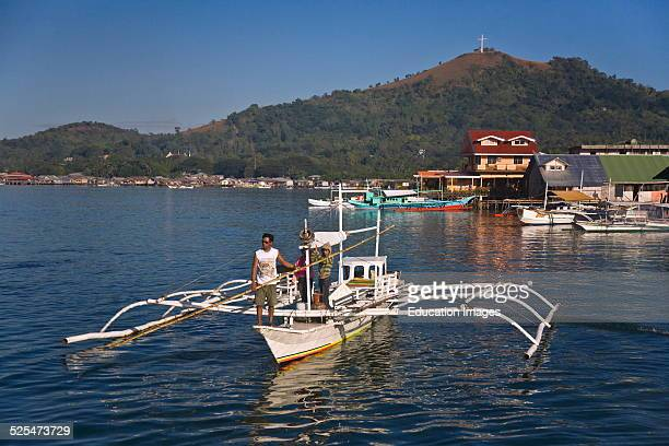 A Small Boat And Coron Town On Busuanga Island In The Calamian Group Philippines