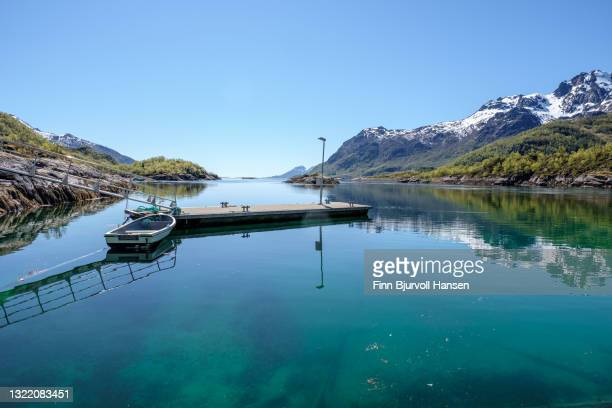 small boat and pier in lofoten norway - finn bjurvoll stock pictures, royalty-free photos & images