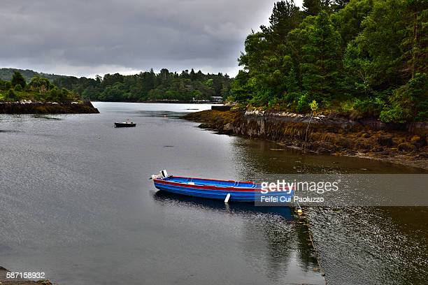Small boat at Seaside of Glengarriff in Cork County, Ireland