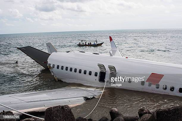 Small boat cruise passes near the wreckage of Lion Air plane on April 15 2013 in Badung Bali Indonesia The Lion Air passenger plane with over 108...