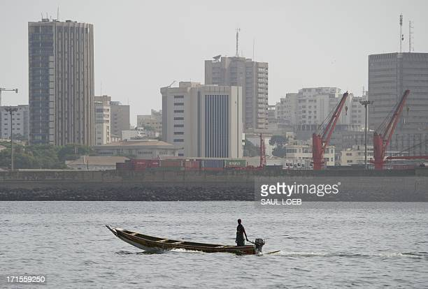 A small boat cruises in the bay off the coast of central Dakar on June 26 2013 US President Barack Obama and his family are set to arrive in the west...