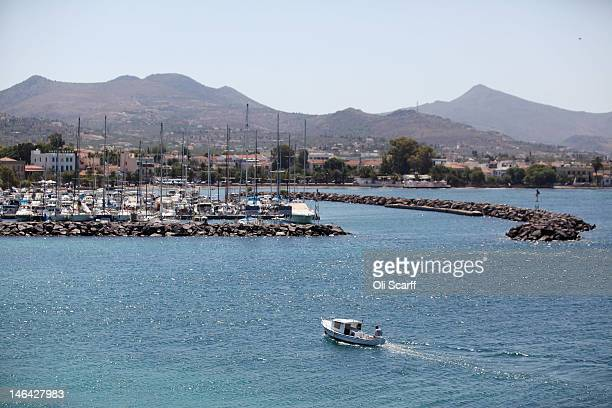 A small boat enters the marina on the island of Aegina on June 16 2012 in Aegina Greece The Greek electorate are due to go to the polls tomorrow in a...