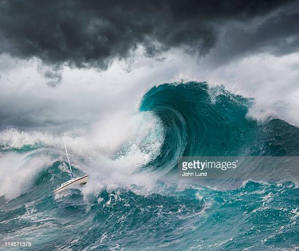 small boat faces a tsunami - tsunami stock pictures, royalty-free photos & images