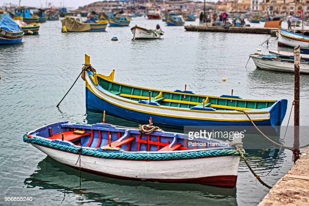 small boat harbour, marsaxlokk, malta - marsaxlokk stock pictures, royalty-free photos & images