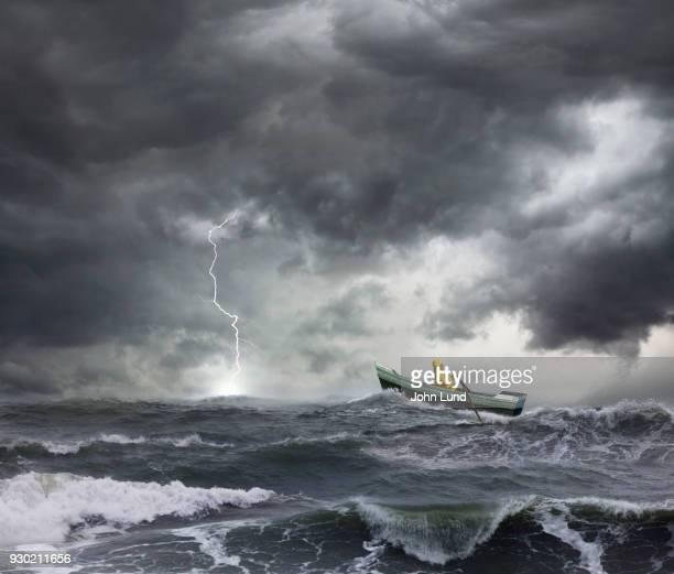 A Small Boat In Rough Seas