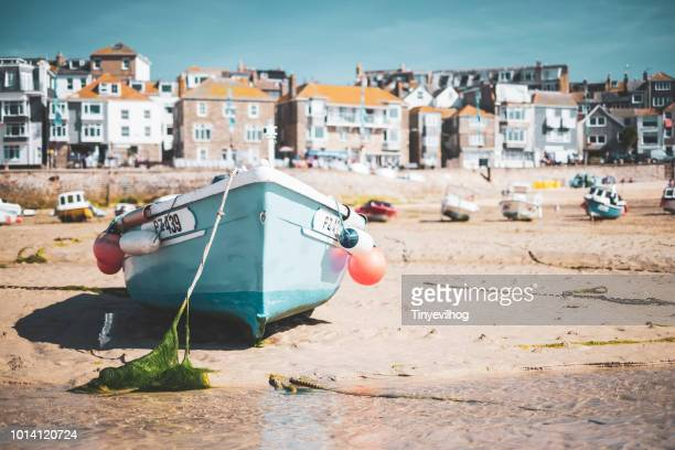 small boat in st ives harbour - coastline stock photos and pictures