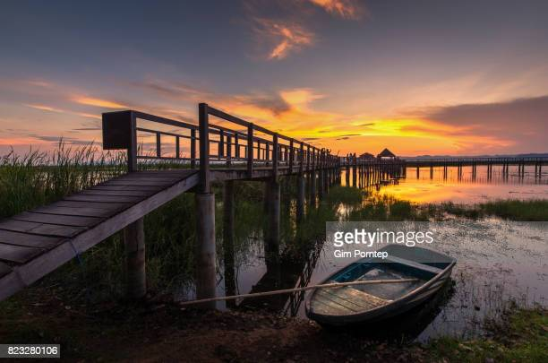 Small boat in the lake during sunset