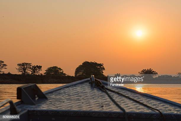 small boat in wetland brazil - cuiaba river stock photos and pictures
