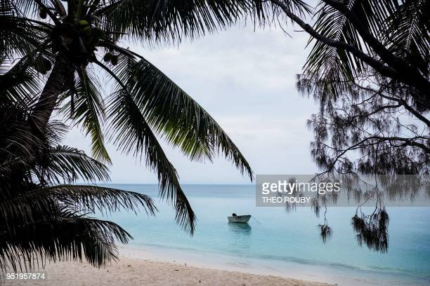 A small boat is moored off the beach of Hwadrilla on the Ouvea island in the French overseas territory of New Caledonia on April 24 2018