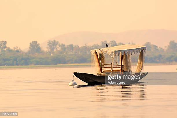 small boat, lake pichola - udaipur stock pictures, royalty-free photos & images