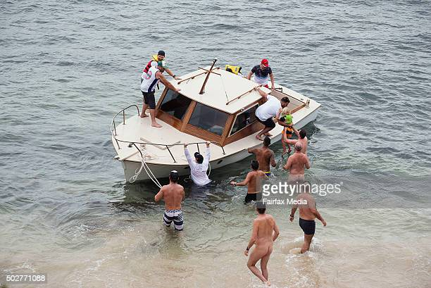 Small boat of spectators runs ashore at Lady Bay Beach after taking on water and then abandoning their boat during the start of the 2015 Sydney to...