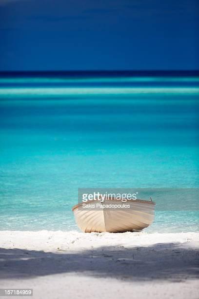 small boat on beach, maldives