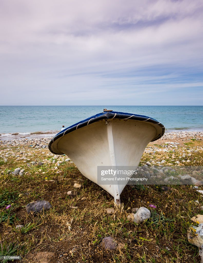Small boat on beach : Stock Photo
