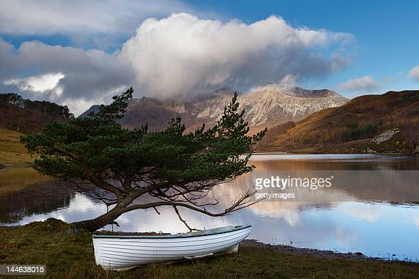 small boat on loch coulin - wester ross stock pictures, royalty-free photos & images