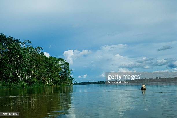 A small boat on the Amazon River in Colombia South America circa 1965