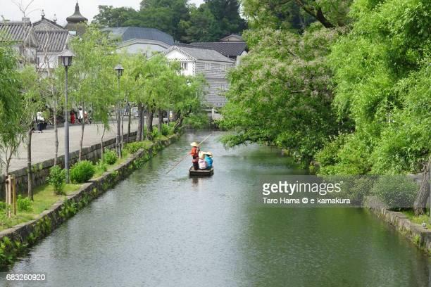 A small boat on the river in Kurashiki Bikan Historical Quarter