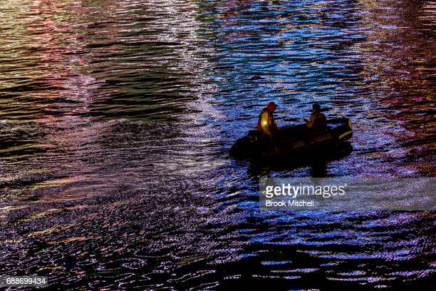 A small boat patrols around Darling Harbour before the magicians of the mist lightshow on May 26 2017 in Sydney Australia Vivid Sydney is an annual...