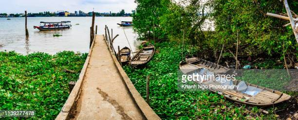 small boat pier in mekong river - floating market stock pictures, royalty-free photos & images