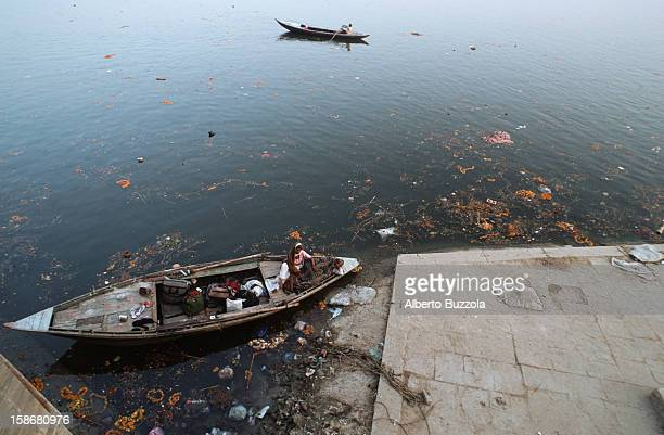 A small boat sailing along the Ganges River The river is considered sacred by the Hindus despite the fact that it's one of the most polluted rivers...