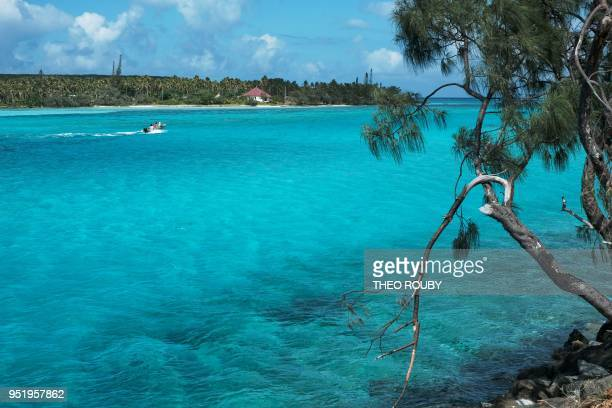 A small boat sails on the Mouli lagoon south of Ouvea island in the French overseas territory of New Caledonia on April 23 2018
