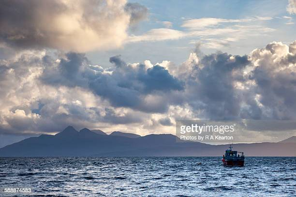 Small boat, view to the Isle of Rum, Scotland