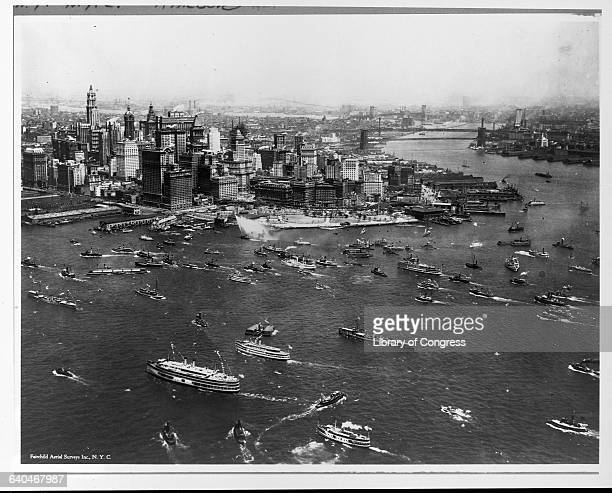 Small boats fill New York Harbor waiting to greet Charles Lindbergh upon his return from France He was the first person to fly solo across the...