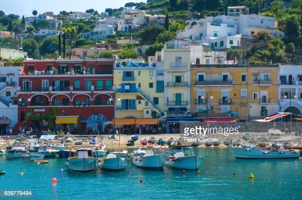 Small boats line the shore in the port of Marina Grande, Capri, Italy