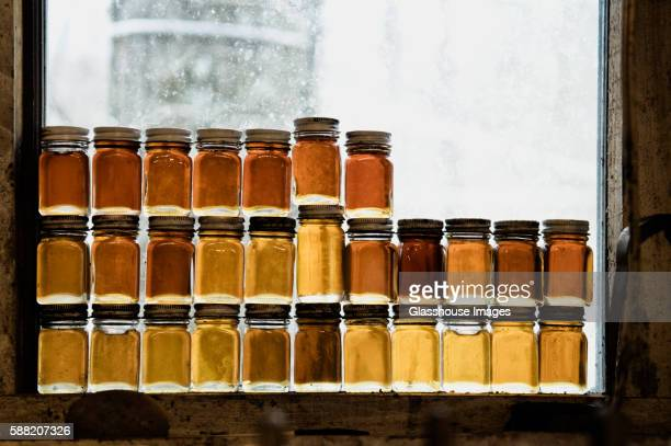 Small Bottles of Maple Syrup in Rustic Window