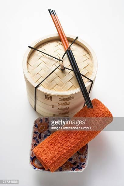 Small bowl, hand towel, chopsticks and bamboo steamer