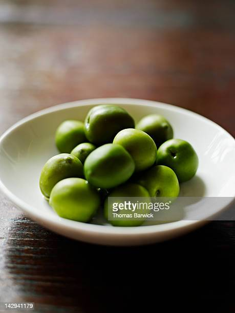 small bowl of castelvetrano olives - green olive stock photos and pictures