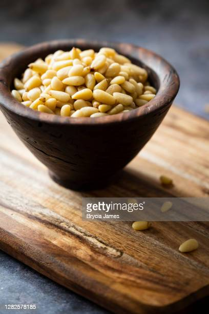 small bowl of raw pine nuts - brycia james stock pictures, royalty-free photos & images