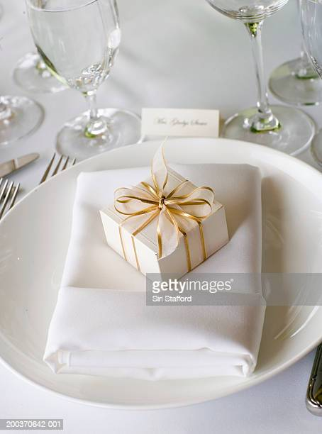 Small box with ribbons on table setting