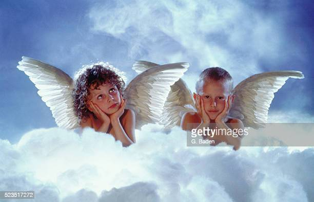 Small boy and girl angels