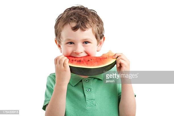 small boy eating watermelon - one boy only stock pictures, royalty-free photos & images