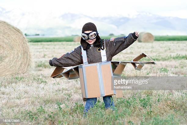 Small boy flying homemade airplane