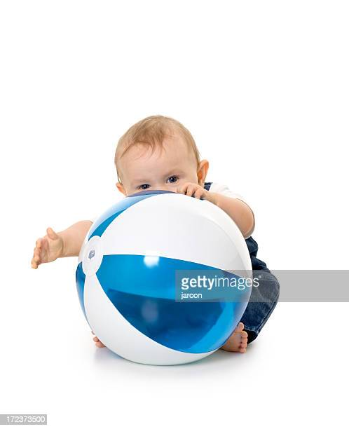 small boy holding big ball - man with big balls stock photos and pictures