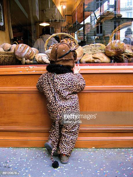 Small boy in front of a bakery