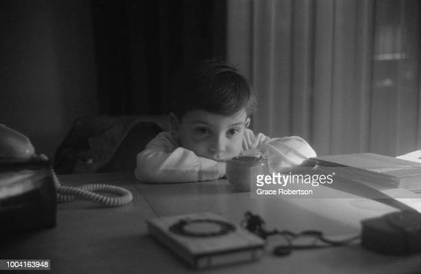 A small boy leaning on a table top Milan November 1951 Original Publication Picture Post 5672 Miss Bluebell Takes Her Girls To Italy pub 9th February...