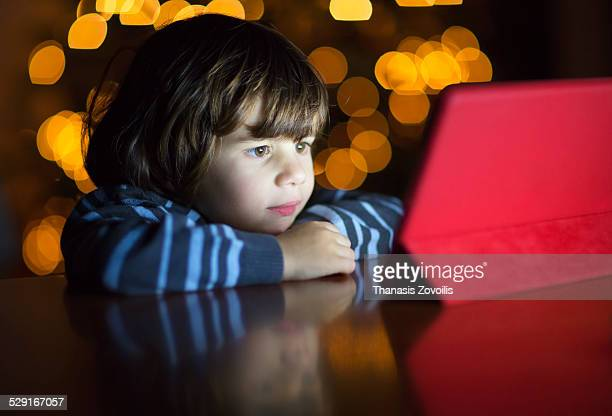 Small boy looking a digital tablet