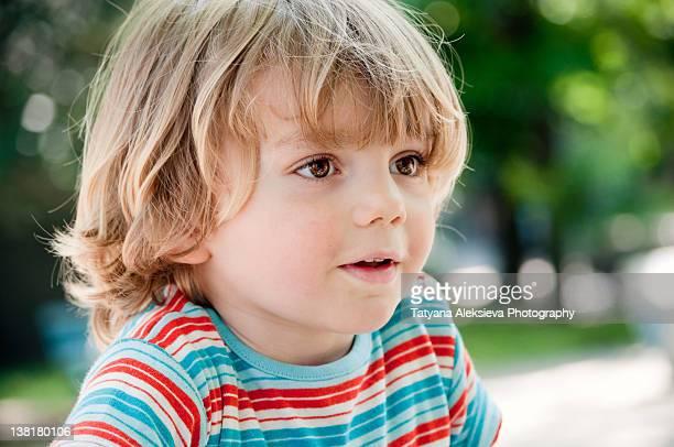 Small boy looking away