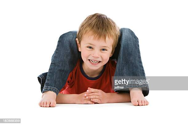 small boy lying in impossibly bendy position - contortionist stock photos and pictures