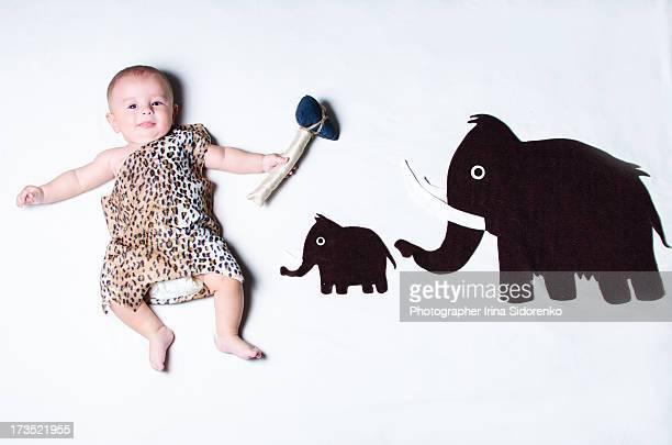 small boy lying with mammoth application - レオパード柄 ストックフォトと画像
