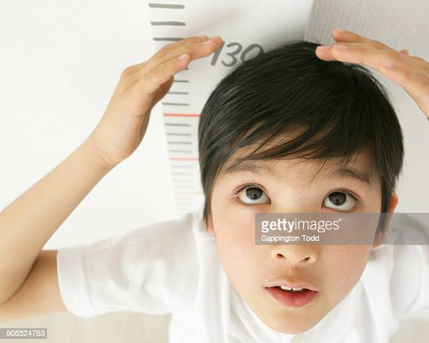 Small Boy Measuring Height