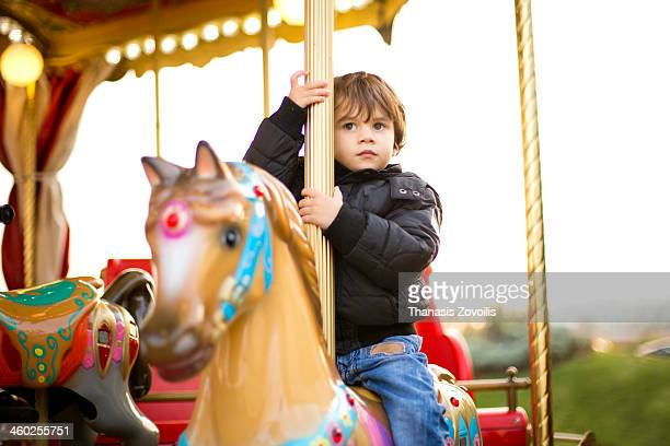 Small boy on a carousel
