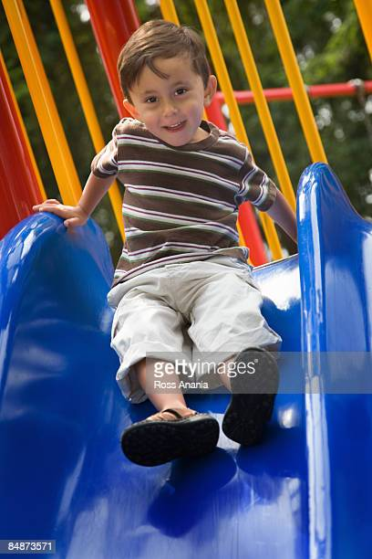 Small boy on slide at playground