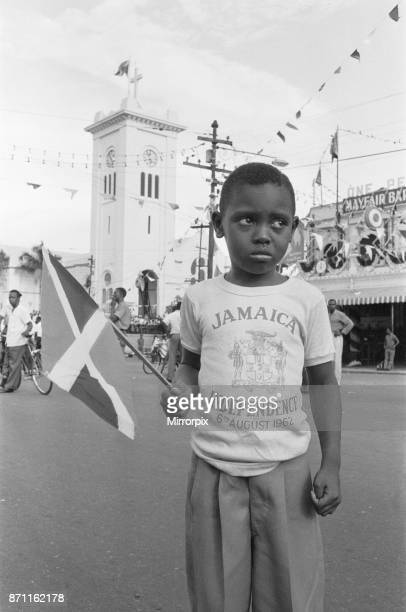 Small boy on the streets of Kingston less than impressed with the celebrations of Jamaician Independence 6th August 1962