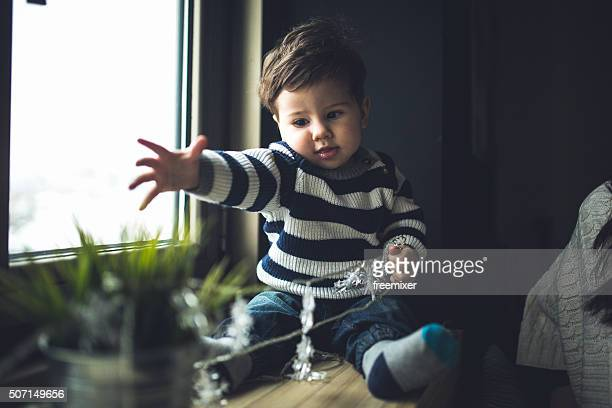 Small boy playing at home